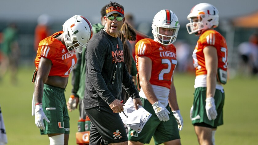 Miami offensive coordinator Dan Enos instructs his players during a practice session on July 29.