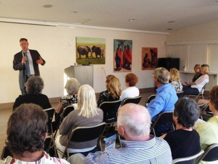 Congressman Scott Peters addresses guests of La Jolla Community Center's Distinguished Speaker Series Aug. 26.  Photos by Pat Sherman
