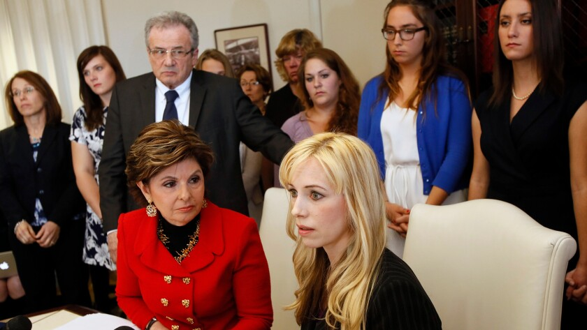 Attorney Gloria Allred, left, and Caroline Heldman, professor of politics, along with 6 sexual assault victims at a news conference to announce a complaint against Occidental.