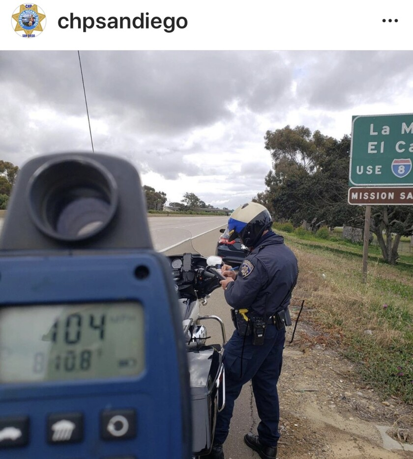 A California Highway Patrol officer issues a citation to a motorcyclist clocked going 104 mph on Interstate 5 in this photo posted by the CHP on Instagram on April 15.