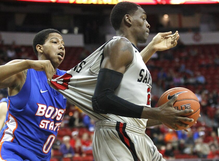 Boise State's Ryan Watkins (left) fouls DeShawn Stephens as SDSU took on the Boise State Broncos in the quarter finals of the Mountain West Tournament in Las Vegas Wednesday night.