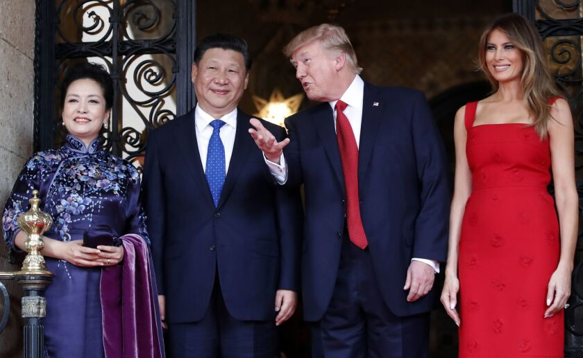 Chinese president Xi Jinping and his wife Peng Liyuan with President Trump and First Lady Melania Tr