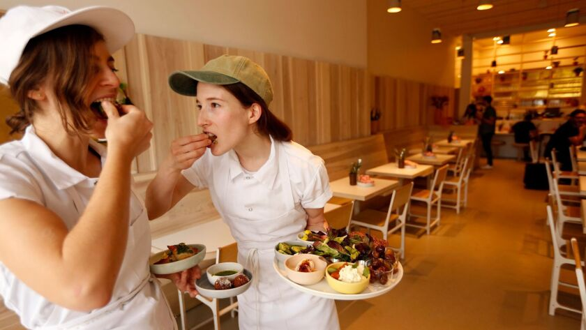 Sara Kramer, left, and Sarah Hymanson, chefs and co-owners of Kismet restaurant, sample some of thei