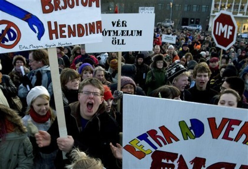 Around 2000 demonstrators crowd into a city square in Reykjavik, Iceland, Monday Dec. 1, 2008, during a protest provoked by the country's economic collapse, waving various posters demanding the resignation of those thought to be responsible. The global credit crunch has brought down the country's three main banks, many businesses have failed, unemployment has risen, prices have shot up, the value of the country's currency, the krona, has plummeted and Iceland is seeking U.S. $10 billion in aid from international funds to support its financial systems. (AP Photo/Brynjar Gunnarsson)