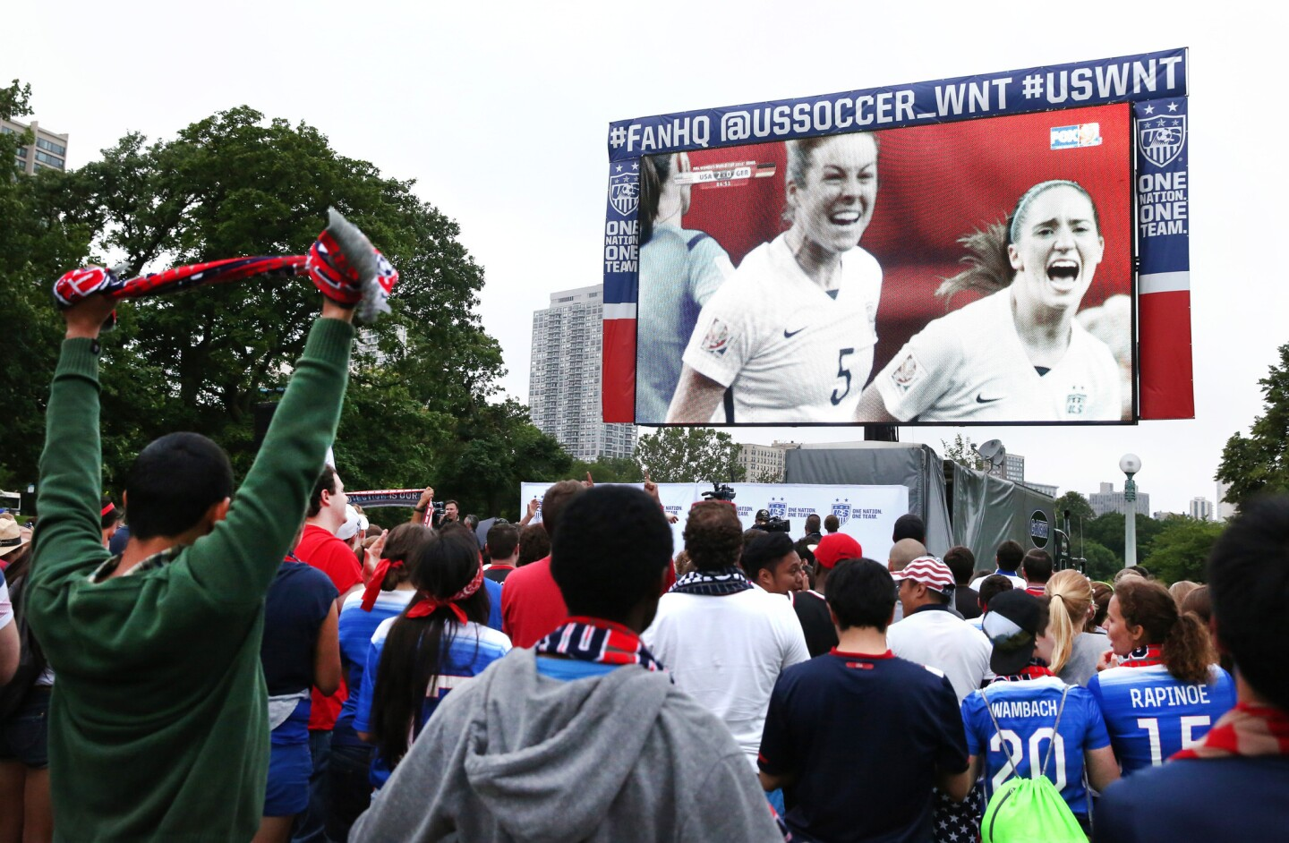 A giant screen at a viewing party in Lincoln Park shows U.S. Women's soccer player Kelley O'Hara (5) celebrating June 30, 2015, after her goal.