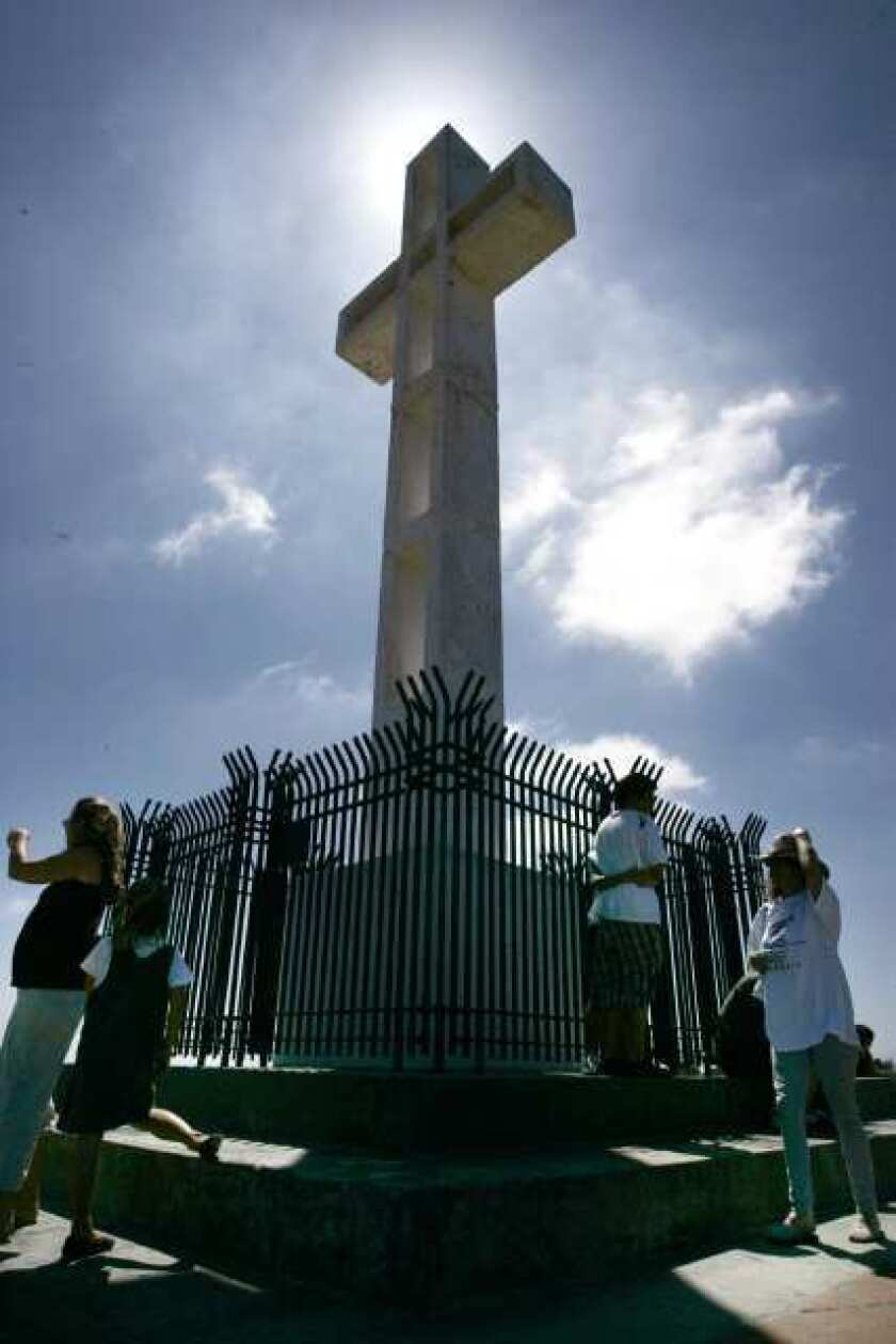 The cross atop Mt. Soledad in San Diego has been at the center of a political and legal dispute for more than two decades. A judge Thursday ordered it taken down as a violation of the separation of church and state. But he has allowed time for appeals.