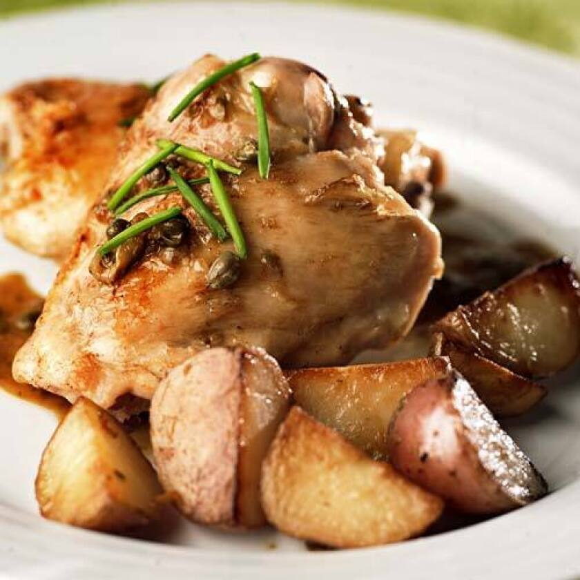 TENDER: Braised chicken with capers and new potatoes.
