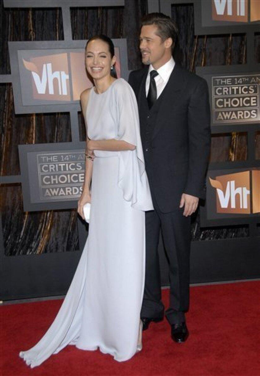 Angelina Jolie and Brad Pitt arrive at the 14th Annual Critics' Choice Awards on Thursday Jan. 8, 2009 in Santa Monica, Calif. (AP Photo/Dan Steinberg)