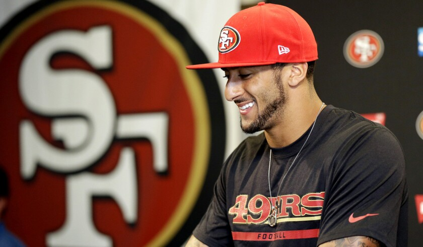 Quarterback Colin Kaepernick addresses the media last week after signing a six-year contract extension with the San Francisco 49ers.