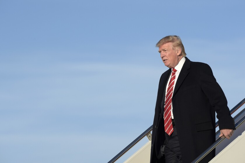 President Donald Trump walks off of Air Force One at Andrews Air Force Base in Md., Monday, Feb. 6, 2017.