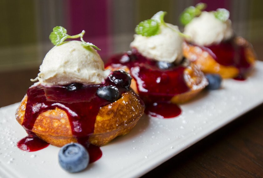 Mini waffles, served in groups of three for sharing, are among the dishes on the new Sunday brunch menu at Parq Restaurant in downtown San Diego.