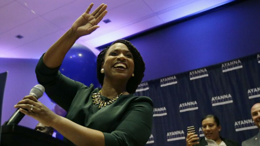 Ayanna Pressley celebrates victory over U.S. Rep. Michael Capuano, D-Mass., in the 7th Congressional House Democratic primary on Tuesday in Boston.