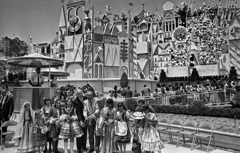 "May 30, 1966: Walt Disney pours water from a canteen into a channel through the new Disneyland attraction ""It's a Small World."""