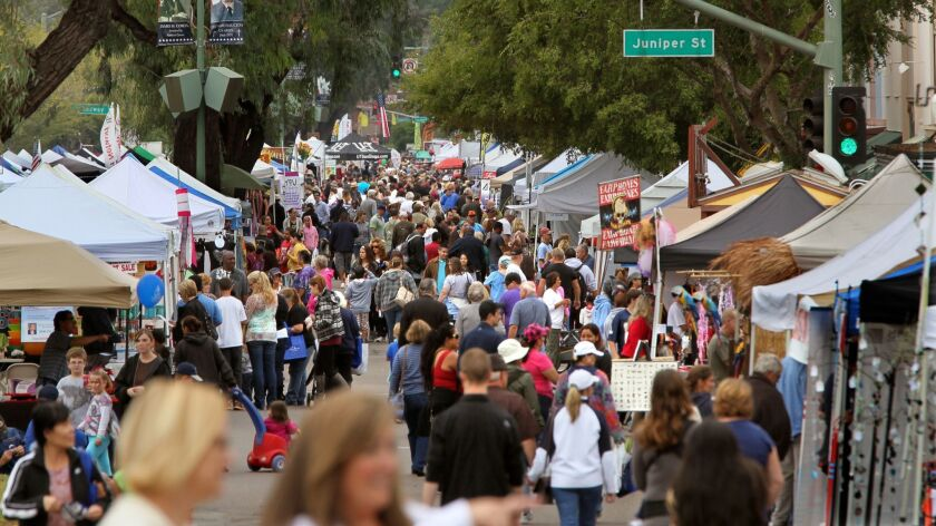The crowd fills Grand Avenue in downtown Escondido in this view looking west during the October 2012