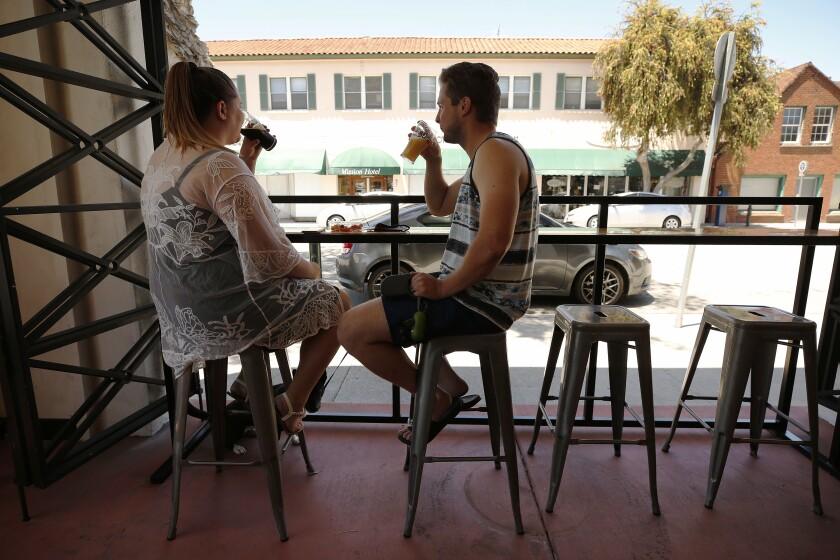 Matt and Leanne Harmon of Santa Clarita enjoy a beer at Ventura Coast Brewing Co.