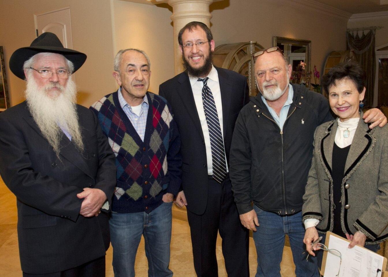 Guest speaker Rabbi Manis Friedman, Pinchas Fisher, Rabbi Levi Raskin, Shlomo and Pnina Gruer