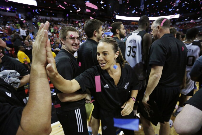 San Antonio Spurs coach Becky Hammon celebrates with her team after they defeated the Phoenix Suns in an NBA summer league championship basketball game Monday, July 20, 2015, in Las Vegas. (AP Photo/John Locher)