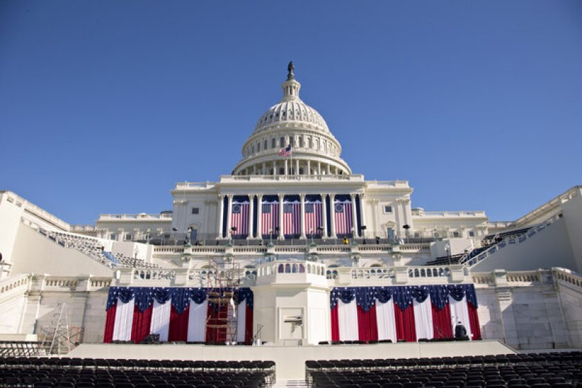 The West Front of the Capitol in Washington is dressed in red, white and blue ahed of the 57th Presidential Inauguration.