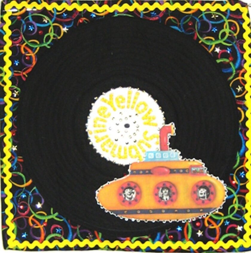 A quilt by La Jollan Judy Warren-Tippets, is part of the Beatles homage at Visions Art Museum, opening Feb. 3. Right: Another Beatles quilt by another La Jollan, 'Yellow Submarine,' by Annemarie Sprinkler.  Courtesy Photos