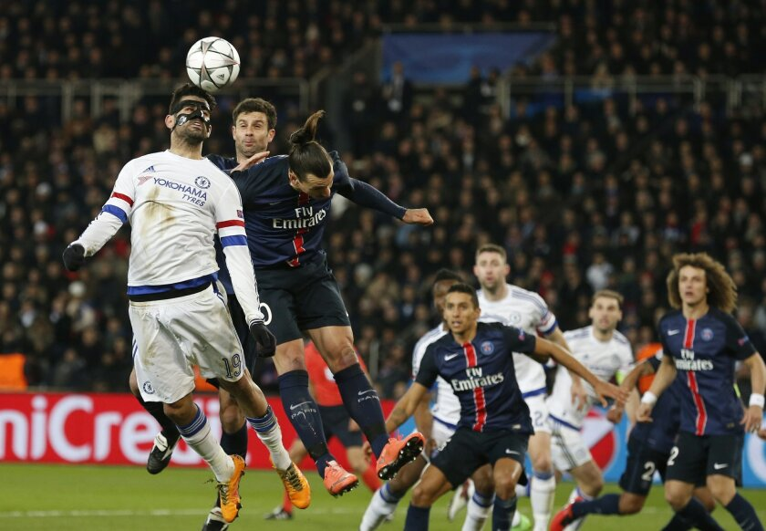 Chelsea's Diego Costa, front heads the ball down for Chelsea's John Obi Mikel, right to score his sides first goal during the Champions League round of 16, first leg, soccer match between Paris Saint Germain and Chelsea at the Parc des Princes  stadium, in Paris, Tuesday, Feb. 16, 2016. (AP Photo/F