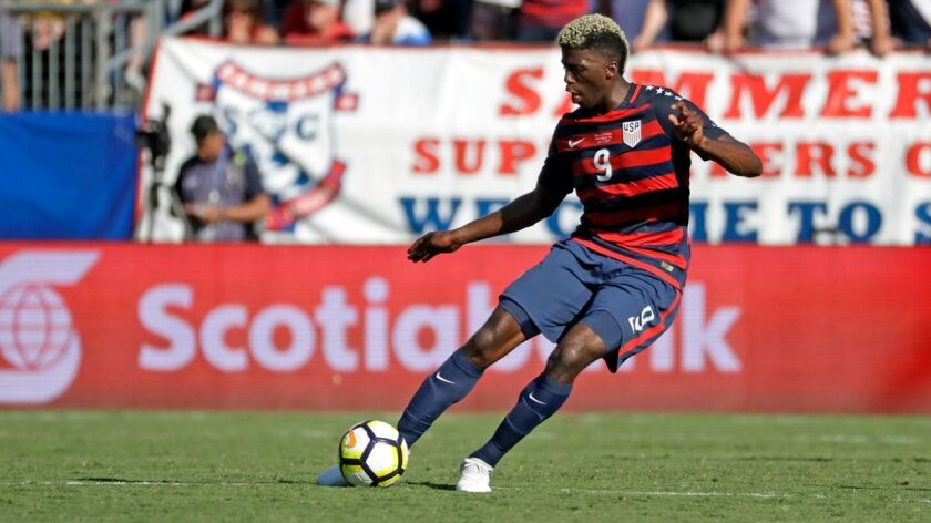 Gyasi Zardes advances the ball during a CONCACAF Gold Cup soccer match between the United States and