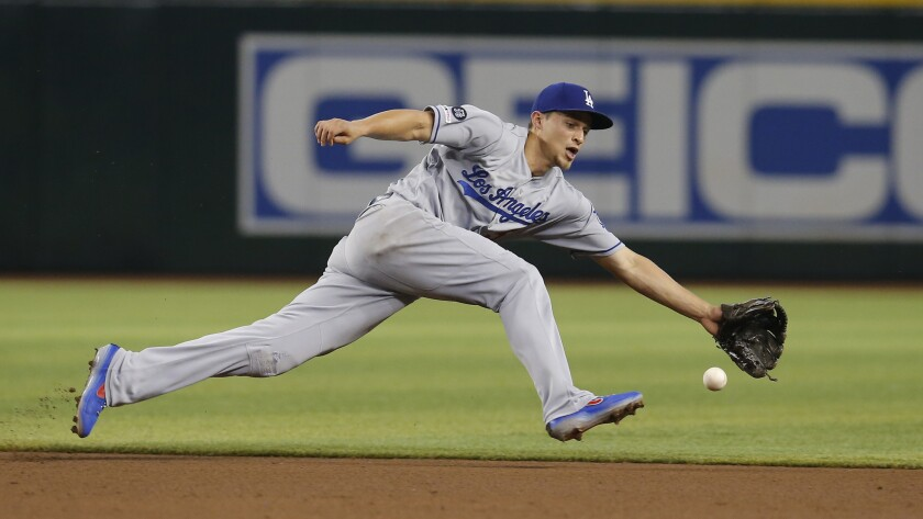 Los Angeles Dodgers shortstop Corey Seager reaches for the ball on a single hit by Arizona Diamondba