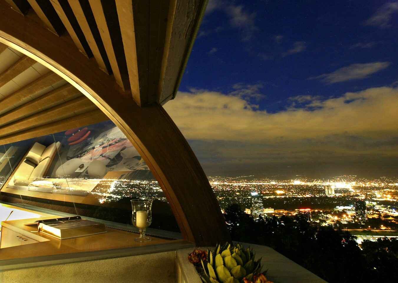 Chemosphere's panoramic windows open up to views of the San Fernando Valley; the other side of house faces a quiet hillside, a scene that can almost feel like a nature preserve.