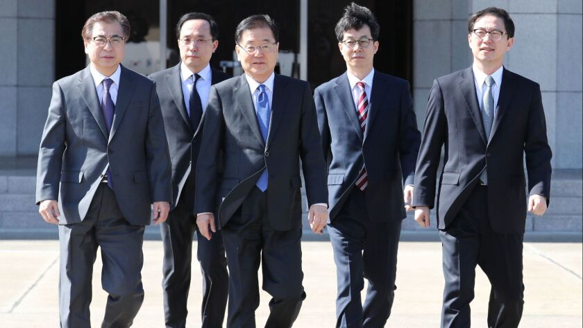 Chung Eui-yong, third from left, the chief of the presidential National Security Office, departs for Pyongyang with other members of South Korea's envoy delegation.