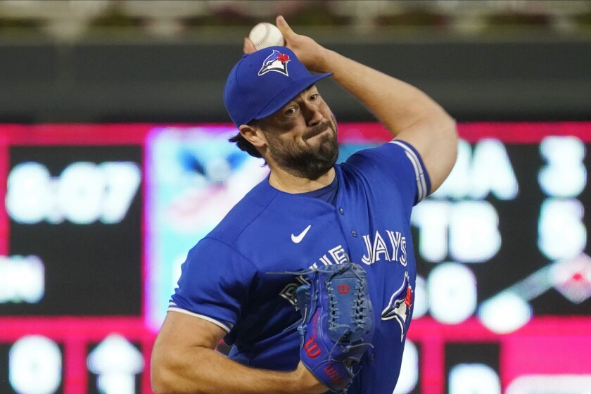 Toronto Blue Jays pitcher Robbie Ray throws against the Minnesota Twins in the first inning of a baseball game, Saturday, Sept. 25, 2021, in Minneapolis. (AP Photo/Jim Mone)