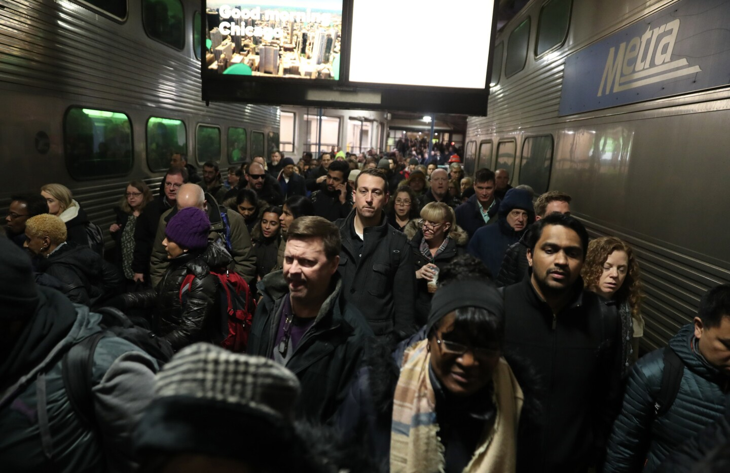 Metra passengers head for a BNSF line train to depart from Union Station on Feb. 28, 2019, in Chicago. An Amtrak computer signal problem caused trains to be delayed throughout the day.