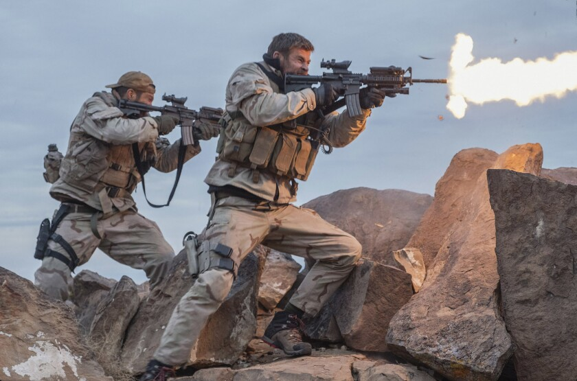 """Geoff Stults, left, and Chris Hemsworth in a scene from """"12 Strong."""""""