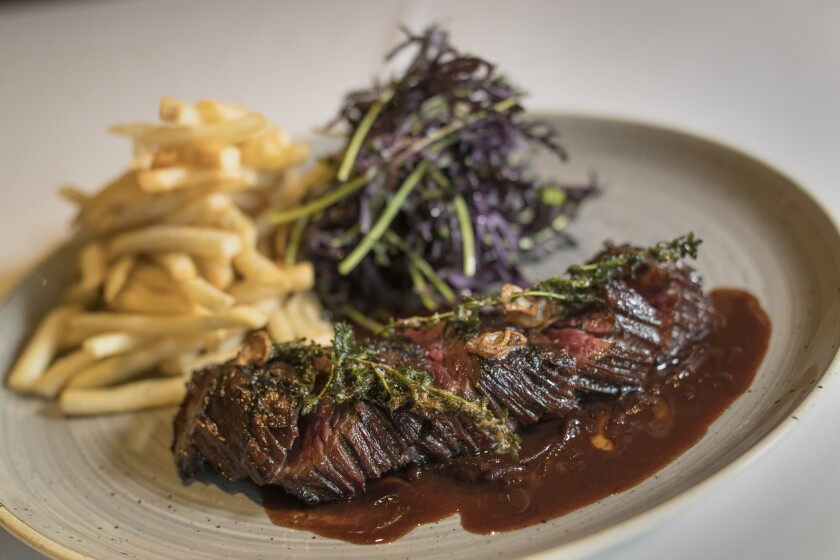 Grilled prime hanger steak, hand-slated spices and shallot jus frites