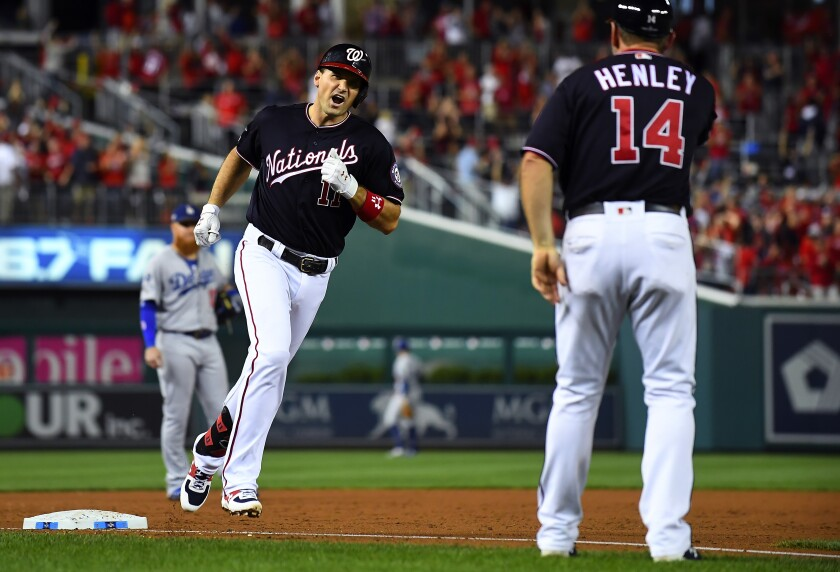 Washington Nationals' Ryan Zimmerman celebrates after hitting a three-run home run off Dodgers pitcher Pedro Baez.