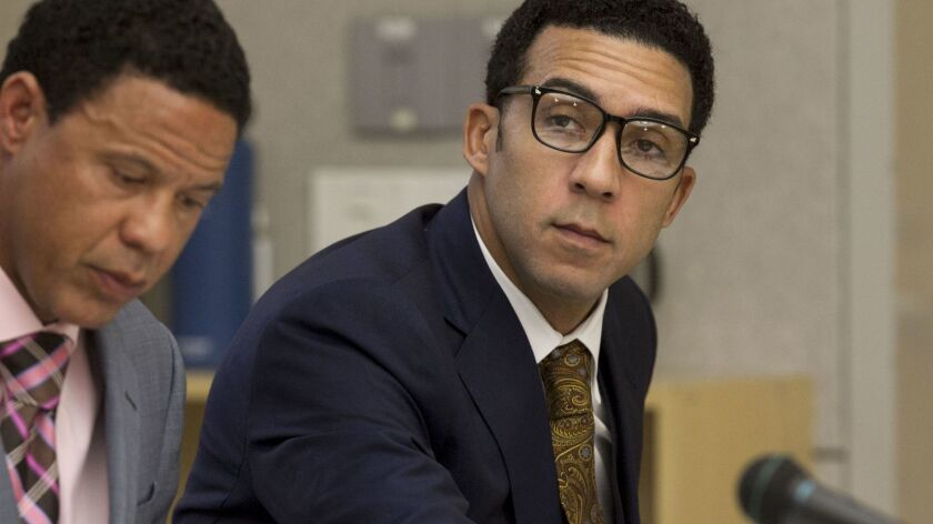Former NFL player Kellen Winslow II, seen here Wednesday during his preliminary hearing at the Vista courthouse, was ordered Thursday to stand trial on rape and other charges. Here, he is seated next to defense attorney Brian Watkins, left.