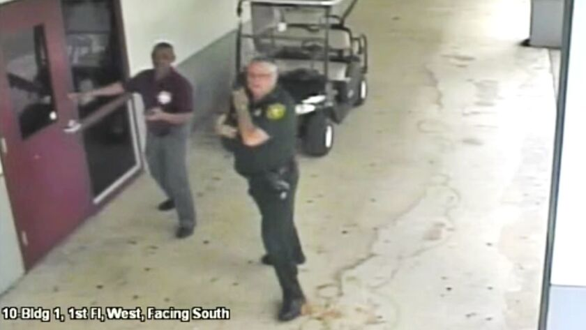 This Feb. 14, 2018 frame from security video provided by the Broward County Sheriff's Office shows d
