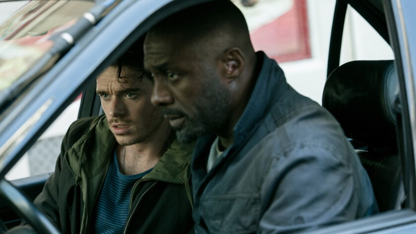 "Richard Madden, left, and Idris Elba in the movie ""The Take."""