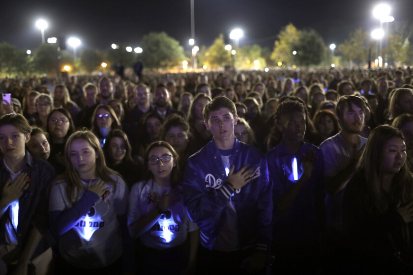 Students say the Pledge of Allegiance as thousands gather at Central Park in Santa Clarita to remember those killed and wounded in the Saugus High School shooting.
