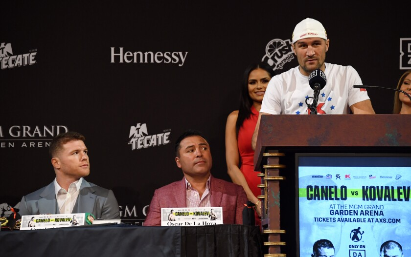 WBO light-heavyweight champion Sergey Kovalev speaks in front of his opponent Canelo Alvarez, far left, during a news conference at the KA Theatre at MGM Grand Hotel & Casino in Las Vegas.