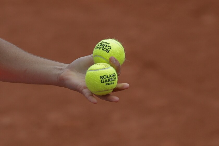 Jennifer Brady of the U.S. prepares to serve against Denmark's Clara Tauson in the first round match of the French Open tennis tournament at the Roland Garros stadium in Paris, France, Tuesday, Sept. 29, 2020. (AP Photo/Alessandra Tarantino)