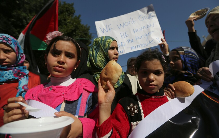 Palestinian children in Gaza City attend a rally in solidarity with Palestinian refugees in Yarmouk refugee camp in Syria on Thursday.