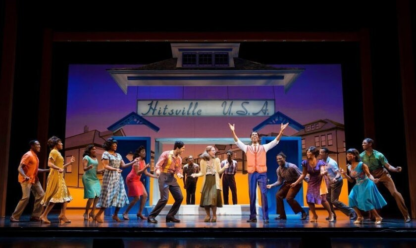 "Julius Thomas III (center right) as Berry Gordy Jr. with the cast of the touring ""Motown: The Musical."""
