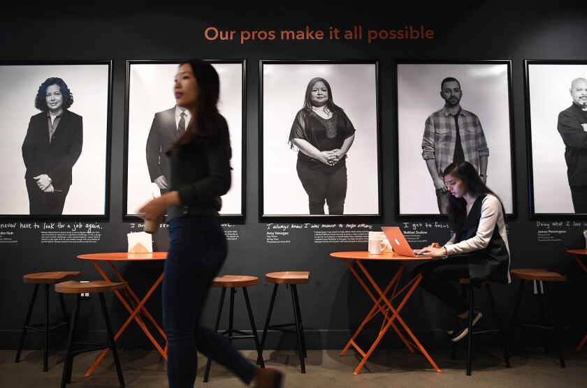 Prachi Pundeer, right, a product designer, works at Thumbtack's office in San Francisco.