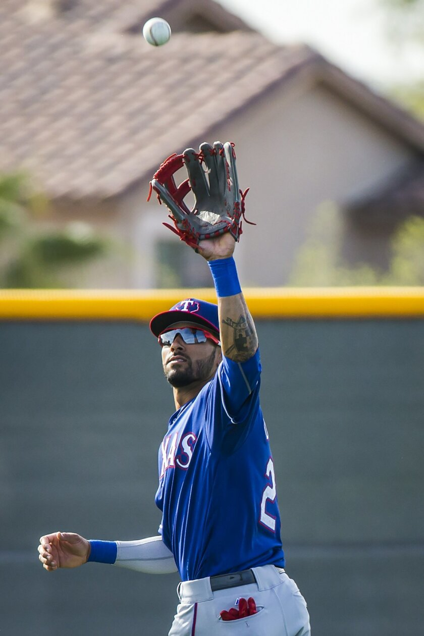 Texas Rangers outfielder Ian Desmond catches a fly ball while participating in a fielding drill during a during a spring baseball workout at the team's training facility, Monday, Feb. 29, 2016, in Surprise, Ariz. (Smiley N. Pool/The Dallas Morning News via AP) MANDATORY CREDIT; MAGS OUT; TV OUT; INTERNET USE BY AP MEMBERS ONLY; NO SALES