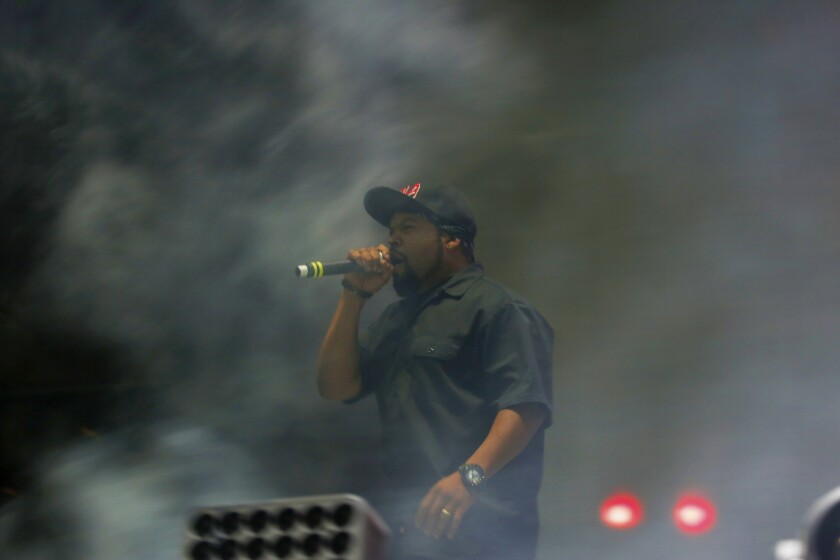Ice Cube performs among the smoke-filled stage during the Hard Summer dance music festival.