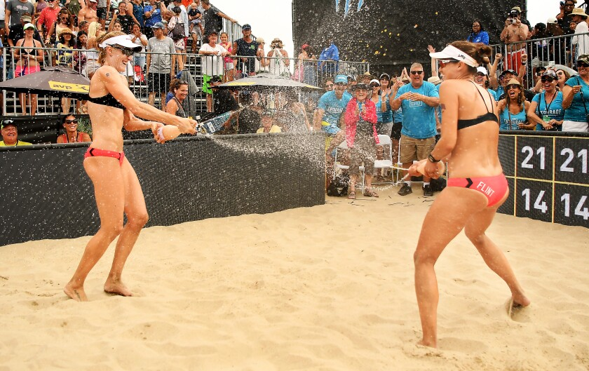 Emily Day, left, and Betsi Flint celebrate after winning the Hermosa Beach Open on Sunday.