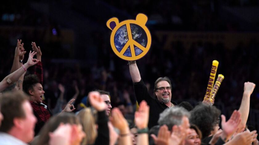 Fans cheer for Lakers forward Metta World Peace after he sank a 3-pointer during the second half aga
