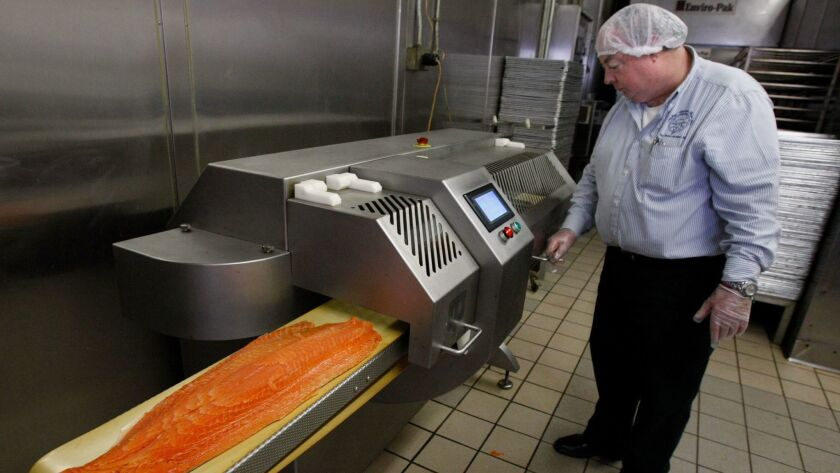 Michel Blanchet with a salmon slicer at Michel Cordon Bleu in March 2010.