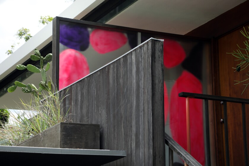 """Adam Francis Scott and Julie Whaley's translucent painting """"Corita, Constance, Richard, and Sharon (A Rose Is a Rose Is a Rose Is a Rose)"""" greets visitors to a 1955 Richard Neutra-designed house."""