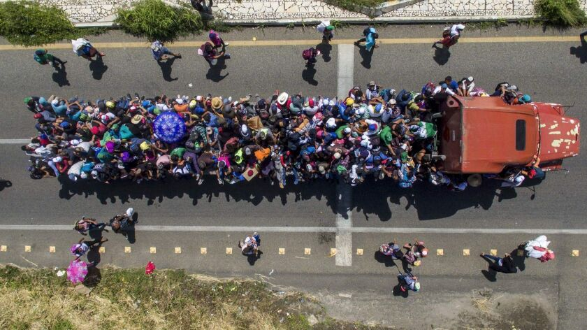 Aerial view of Honduran migrants onboard a truck in Mexico as they take part in a caravan heading toward the U.S.