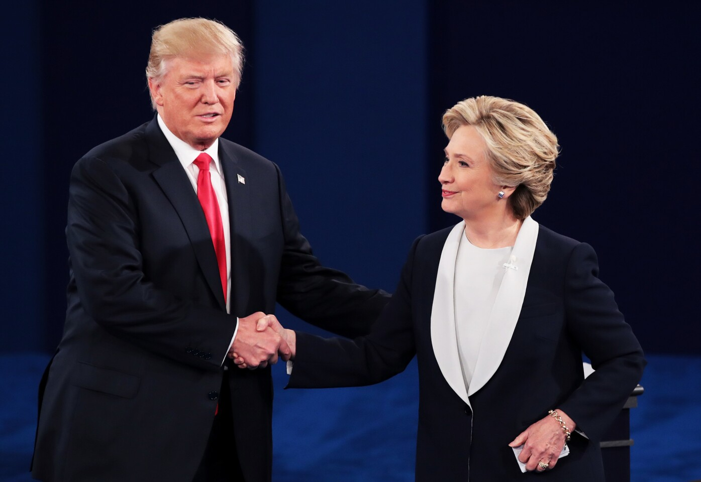 Donald Trump and Hillary Clinton shake hands at the end of their town hall debate.